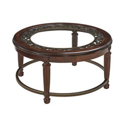 Ashley Leahlyn Round Coffee Table in Reddish Brown