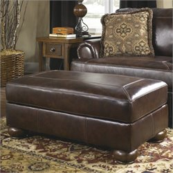 Ashley Furniture Axiom Leather Ottoman in Walnut