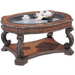 Bowery Hill Oval Glass Top Coffee Table in Antique Brown