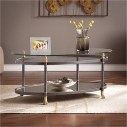 Bowery Hill Oval Glass Top Coffee Table in Gold