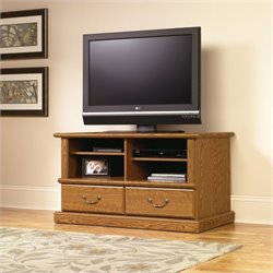 Pemberly Row TV Stand in Carolina Oak